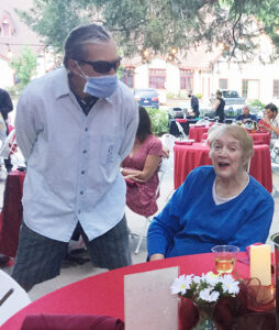 Dr. Hugh Bialecki visits with Blue Jay Jazz Foundation supporter Gloria Anderson at the Tudor House on August 12.
